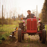 "Nicholas Schaut, owner of Bighead Hops in Meaford, uses his ""weed badger"" to care for his crops. Schaut adopts a ""gentleman farmer's"" uniform of tweed jacket and Wellington boots inspired by George Harrison."
