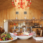 A giant bright red chandelier hangs from the raw pine-vaulted ceiling at Creemore Kitchen. The chandelier and much of the mismatched furniture has been repurposed, creating a casual, funky vibe with a touch of elegance – the perfect backdrop for CK's scrumptious food.