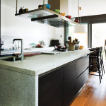 The latest kitchen trends are all about clean lines, with flat-front cabinets and muted countertops with same-level seating. Some designers are even doing away with upper cabinets in today's contemporary kitchens.
