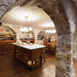 "This man cave, dubbed ""the grotto"" by the homeowner, was designed to mimic an authentic Italian restaurant, including stone arches, vaulted ceilings, pizza oven and marble prep table."