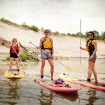 Jennie Elmslie of Free Spirit Tours (left) gives a SUP lesson to Pam Paylor (centre) and Sonya Reiner.