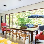 Accordion glass doors from NanaWall create a large opening to the outside in the home of Marina Farrow of FAD Design in Collingwood, creating a seamless flow between indoors and out. The outdoor furniture is from Lee Industries. Cooking takes place on a gas grill and a Green Egg Charcoal barbecue built into a custom table. Tucci umbrella is from Squire John's on Hwy. 26.