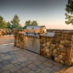 The Landmark Group of Thornbury built this fully outfitted outdoor kitchen. Appliances are now designed to be left outdoors all year round. Barbecue grills built into rock-faced islands allow for generous counter space.