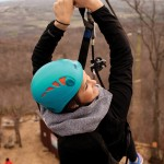 Constance DeDecker of Stratford rides the zip line at Scenic Caves.