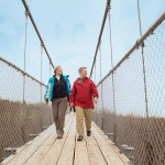 "Writer Laurie Stephens (right) strolls along the suspension bridge at Scenic Caves with Karen Hall of Wasaga Beach and Toronto. The longest footbridge in Southern Ontario, it ""cost $1 million to build and has million-dollar views."""