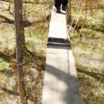 It's one foot in front of the other along the treetop canopy walk, a two-by-10-inch wooden plank supported by ropes.
