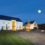 Golden interior lights, subtle mood lighting and a full moon give the Barn a glowing presence.