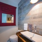 """Graffiti"" ceramic tile from Metro Source add a touch of whimsy in the powder room. The vessel sink and Toto toilet are from Ginger's."