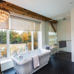 In the master bathroom the extra long Merit Tub is from Penmar and the Robert Abbey Bling pendant from Royal Lighting. Blinds and drapery hardware throughout the house are from Ashton's in Thornbury.