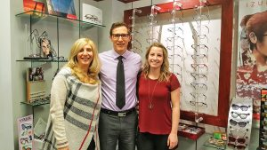 Optometry receptionist Anna Duni, optometrist Dr. Andrew Comly and optician Olivia Peikos at Comly Eye Care's Wasaga Beach location.
