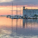 PHOTO BY RICHARD GARNER - The sun sets over Collingwood Harbour and the Collingwood Terminals building.