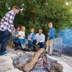 The firepit, with its circle of weathered cedar chairs, was a selling feature when Jim and Maricke Emanoilidis decided to buy this weekend home for their family. Here, they gather with Owen and Parker, 9, and Bridget and Ada, 5.