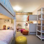 Five-year-old twin girls share a bedroom, which has two sets of bunk beds for sleepovers with friends.