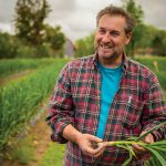 Tim Schneider says leaving the stalks on the bulbs improves the flavour of the garlic while attesting that Dunridge Farms garlic is grown locally and organically.
