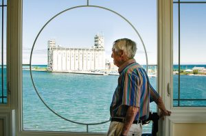 John Wiggins takes in the view of the iconic Collingwood Terminals from his Shipyards condo.