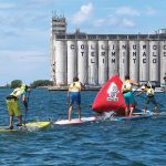 PHOTO BY DAVE WEST - Stand-up paddle board races and demos are among the activities during Sidelaunch Days Festival, a two-day waterfront event celebrating Collingwood's shipbuilding history, to be held this year on August 12 and 13.