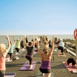 Practitioners take a yoga class on the Thornbury Pier.