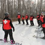 "Patrollers at Alpine Ski Club gather before ""closing sweep"" at the end of the day: Angela Sibbald, Shanna Reid, Susie Shymko (facing away), Paul Aitkens, Jackie Bizzell, Judy Ross, John Ackery, Paul Eichenberg, Jim Ross, Ailie Young, Andrea Vincze."