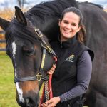 Animal chiropractor Dr. Taron Carruthers works with Trixie