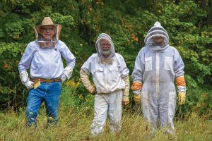 Harvesting the honey (l-r): Brent Flanakin, Richard Elzby and Jacob Smith.