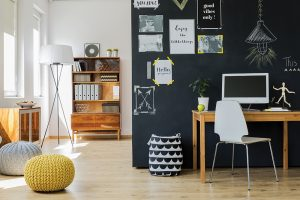 Matte black chalkboard paint in a kitchen or office is practical while also making a decorating statement.